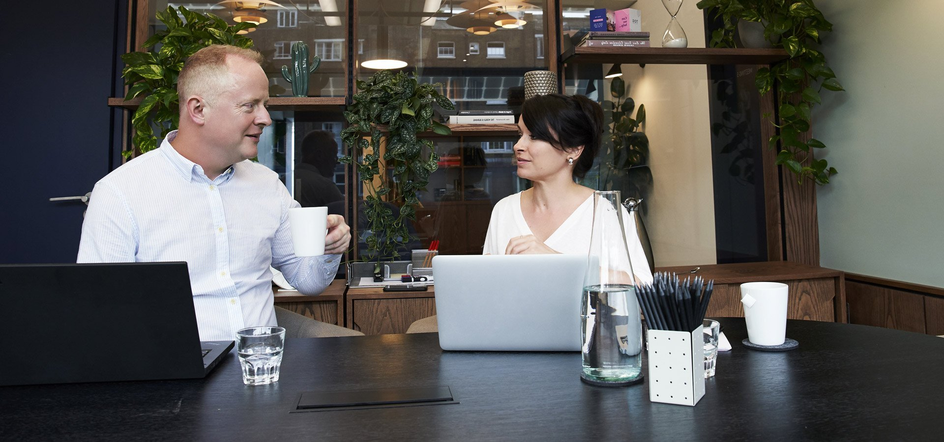 Two business owners in a coffee meeting