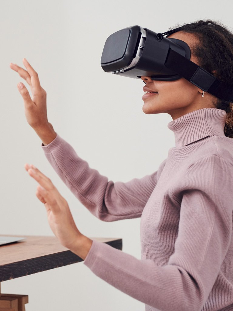 A woman using a Virtual Reality headset